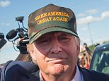 AMES, IA - SEPTEMBER 12:  Republican presidential candidate Donald Trump greets fans tailgating outside Jack Trice Stadium before the start of the Iowa State University versus University of Iowa football game on September 12, 2015 in Ames, Iowa. Several GOP candidates campaigned at the event.  (Photo by Scott Olson/Getty Images)