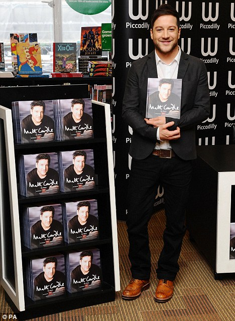 All smiles: Matt shows no sign of his big night out as he gets ready to sign  copies of his new book at Waterstones in London