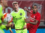 FC Twente Enschede's Jerson Cabral (R) vies for the ball with Ajax Amsterdam's Daley Sinkgraven (C) during a Football league match between FC Twente Enschede and Ajax Amsterdam on September 12, 2015 in Enschede. AFP PHOTO / ANP / OLAF KRAAK ==NETHERLANDS OUT==OLAF KRAAK/AFP/Getty Images