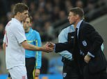 England Caretaker Manager Stuart Pearce and and injured Steven  Gerrard . REXMAILPIX.