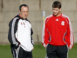 Steven Gerrard talks to manager Rafael Benitez during training for Liverpol FC..
