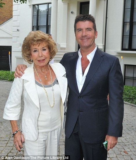 Close relationship: But Julie Cowell is still waiting for Simon to name a date for his wedding