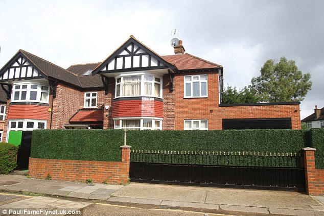 One elderly resident complained that a plastic hedge shielding the front windows of the home (pictured) stood out 'like a sore thumb'
