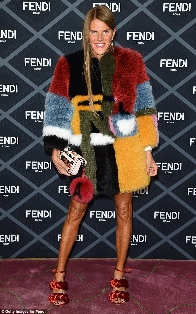Anna Dello Russo has long been a fan of clashing colours and fluffy accessories. Picture: Dressed in brightly coloured Fendi furs for Paris Fashion Week Haute Couture Fall/Winter 2015