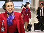 EXCLUSIVE Bachelor star Sandra is pictured for the first time in her Virgin Airlines uniform. Seen here Sunday night leaving a flight in Sydney which had come from Melbourne. Sandra was previously a school teacher in Melbourne before she decided to start flying in recent weeks. MUST CREDIT DIIMEX.COM