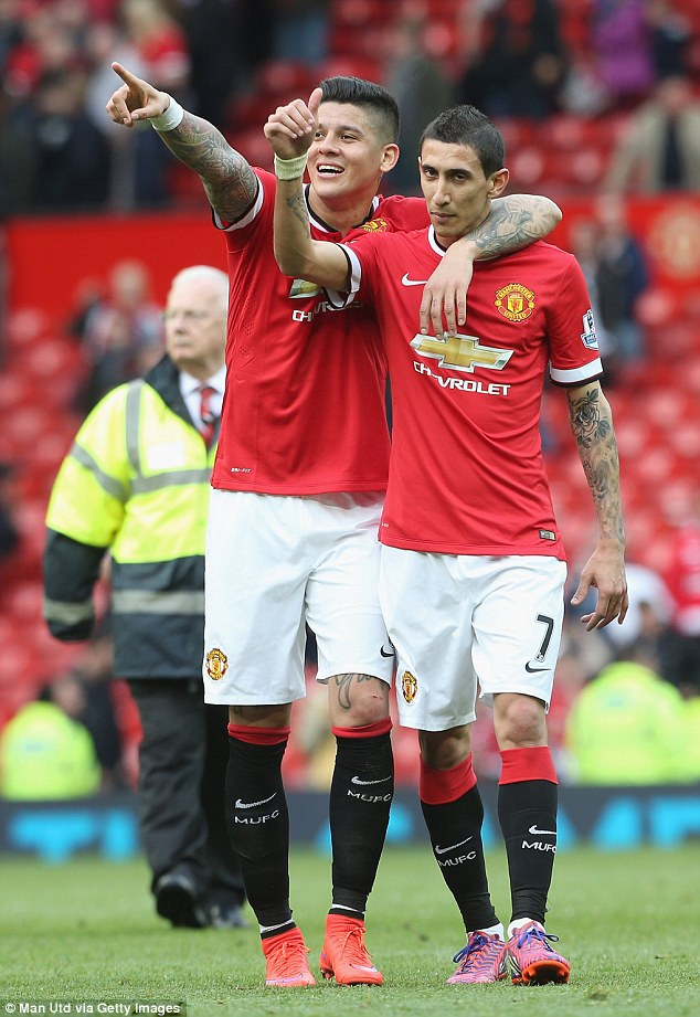 'Cheesy': Rojo celebrates Manchester United's 3-1 win yesterday with Angel di Maria