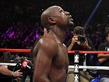 Floyd Mayweather Jr. kneels at the end of his welterweight title boxing bout against Andre Berto on Saturday, Sept. 12, 2015, in Las Vegas. (AP Photo/John Locher)