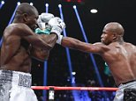Floyd Mayweather Jr, right, hits Andre Berto during their welterweight title fight Saturday, Sept. 12, 2015, in Las Vegas. (AP Photo/Steve Marcus)