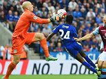 LEICESTER, ENGLAND - SEPTEMBER 13:  Nathan Dyer of Leicester City (24) beats goalkeeper Brad Guzan of Aston Villa to score their third goal during the Barclays Premier League match between Leicester City and Aston Villa at the King Power Stadium on September 13, 2015 in Leicester, United Kingdom.  (Photo by Michael Regan/Getty Images)