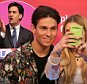 Joey Essex with a fan taking a selfie at a Labour rally held at Parr Hall, Warrington. PRESS ASSOCIATION Photo. Picture date: Saturday April 4, 2015. See PA story ELECTION Labour. Photo credit should read: Chris Radburn/PA Wire     chris irvine