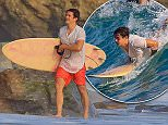 Orlando Bloom fighting the California heat wave with a day of surfing on friday showing off his skills.jpg