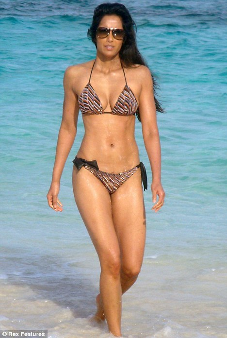 Beach body: Padma Lakshmi showed off her toned physique as she strolled along the beach in the Bahamas on Saturday