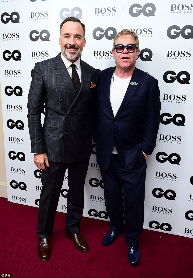 Sir Elton John has two sons, Zachary, four, and Elijah, two, with his husband, David Furnish (pictured together)
