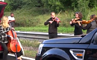 Motorists left stranded on a motorway were treated to an impromptu roadside concert - by a string quartet