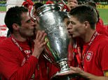 Liverpool captain Steven Gerrard (R) and defender Jamie Carragher kiss the European Cup after Liverpool won the European Champions League final against AC Milan on May 25, 2005 at the Ataturk Olympic Stadium in Istanbul, Turkey.   UEFA Champions League Final - AC Milan v Liverpool (3-3 a.e.t.-Liverpool won 3-2 on pens). ISTANBUL, TURKEY - MAY 25:  (Photo by Clive Brunskill/Getty Images) 52967504 EOS1DMkII-233629