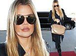 Khloe Kardashian showing up makeup powder and huge lips at LAX  sept 13, 2015 X17online.com