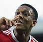 MANCHESTER, ENGLAND - SEPTEMBER 12:  Anthony Martial of Manchester United celebrates after scoring a goal to make it 3-1 on his debut during the Barclays Premier League match between Manchester United and Liverpool on September 12, 2015 in Manchester, United Kingdom.  (Photo by Matthew Ashton - AMA/Getty Images)