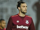 """Football - West Ham United v Newcastle United - Barclays Premier League - Upton Park - 14/9/15  West Ham United's Andy Carroll warms up before the game  Action Images via Reuters / John Sibley  Livepic  EDITORIAL USE ONLY. No use with unauthorized audio, video, data, fixture lists, club/league logos or """"live"""" services. Online in-match use limited to 45 images, no video emulation. No use in betting, games or single club/league/player publications.  Please contact your account representative for further details."""