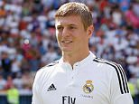 MADRID, SPAIN - JULY 17:  (SPAIN OUT) Toni Kroos poses for photographers in his new Real Madrid shirt during his official unveiling at Santiago Bernabeu Stadium on July 17, 2014 in Madrid, Spain. Toni Kroos who won the World Cup with Germany in Brazil is Real Madrid's first signing in the new season.  (Photo by Pablo Blazquez Dominguez/Getty Images)