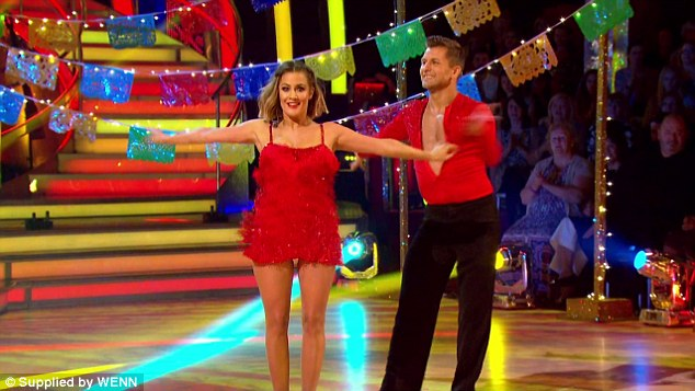 Caroline Flack took to the dance floor in a fringed red dress to perform a sassy routine after lifting the trophy last year