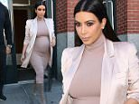 Kim Kardashian is pretty in pink while attending the launch of the Kardashian/Jenner Apps at Apple in NYC. September 14, 2015 X17online.com