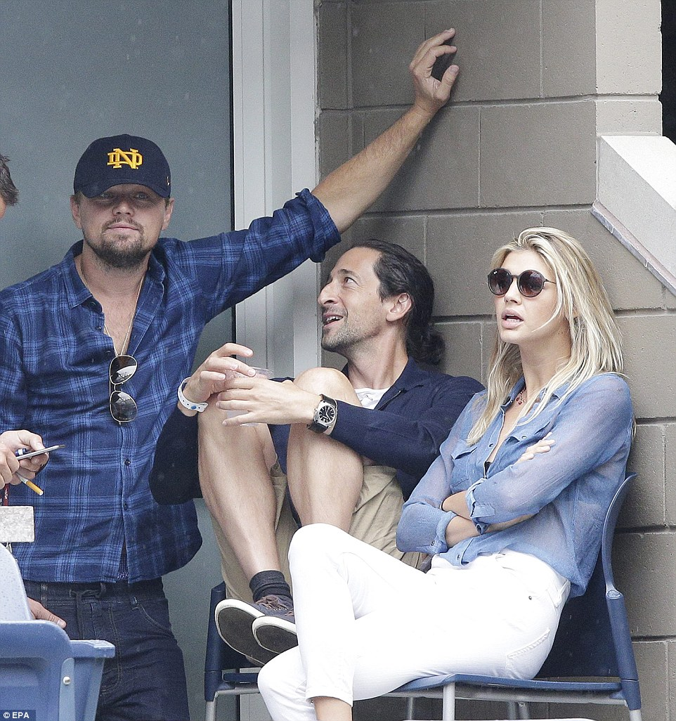 Leonardo DiCaprio looks extremely relaxed as he talks to US model Kelly Rohrbach (right) and US actor Adrien Brody (centre)