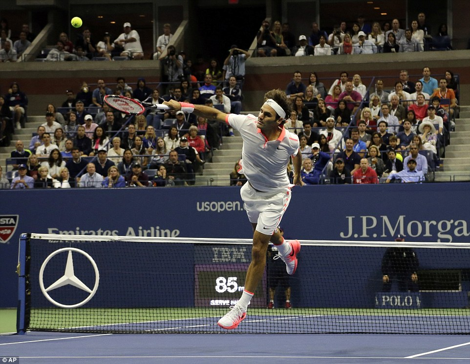 Federer leaps in the air as he makes an attempt to return the ball to his sporting rival in front of the watching New York crowd