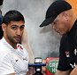 Boxer Amir Khan and trainer Virgil Hunter during the media workout at the Gloves Community Centre, Bolton.   PRESS ASSOCIATION Photo. Picture date: Monday March 24, 2014. Amir Khan will fight Luis Collazo on Floyd Mayweather's undercard in Las Vegas on May 3, Khan's management team have announced. See PA story BOXING Khan. Photo credit should read: Peter Byrne/PA Wire.