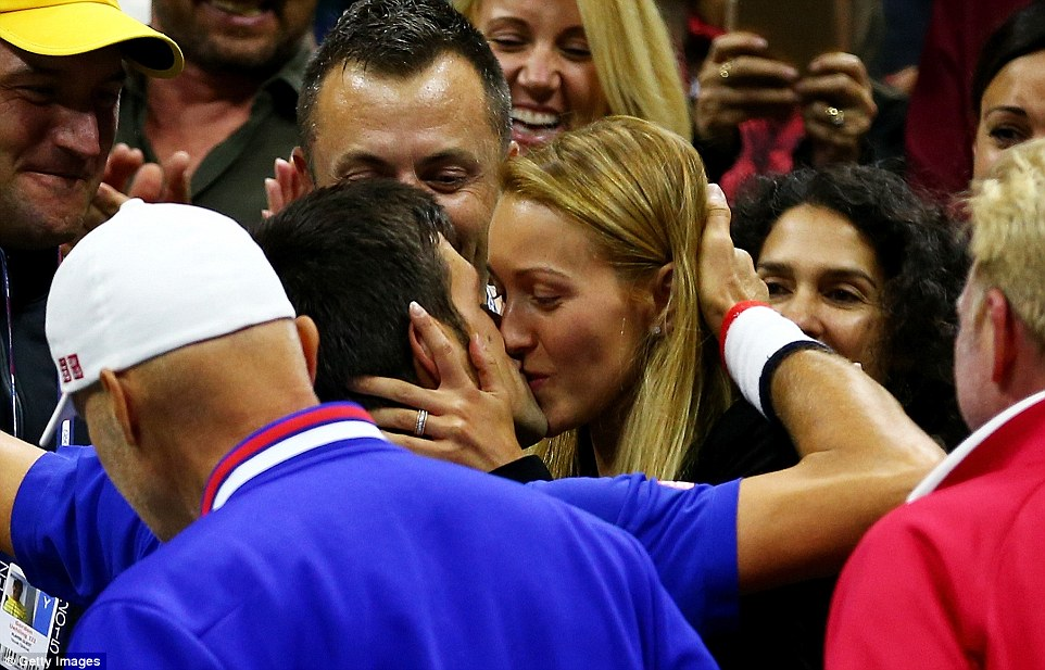 The new US Open champion shares a kiss with his wife Jelena immediately after his victory over Federer in the final