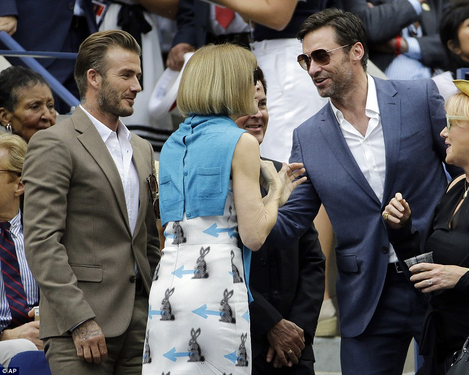 Actor Hugh Jackman greets Wintour and Beckham as he takes to his seat before Sunday's US Open final at Flushing Meadows