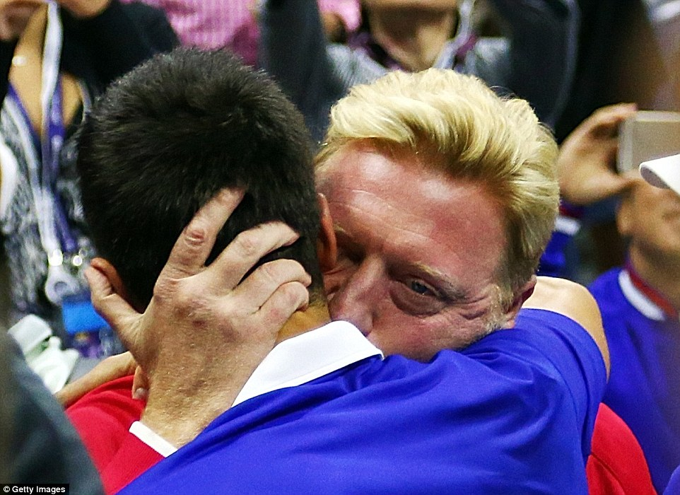 Djokovic hugs his coach Boris Becker after his four-set victory over Federer in Sunday's US Open final in New York