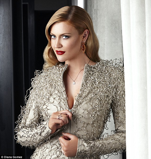 'I may as well make the most of my breasts while I still have them,' said Camilla Kerslake (she is wearing: COAT DRESS, Zyanya Keizer; JEWELLERY, Gemporia and IAM by Ileana Makri)