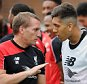LIVERPOOL, ENGLAND - AUGUST 22:  (THE SUN OUT, THE SUN ON SUNDAY OUT) Brendan Rodgers manger of Liverpool talks with Roberto Firmino during a training session at Melwood Training Ground on August 22, 2015 in Liverpool, England.  (Photo by Andrew Powell/Liverpool FC via Getty Images)