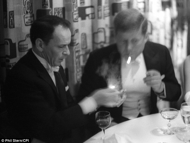 Corridors of power: Stern also took this intimate photo of Sinatra lighting a cigarette for President John F. Kennedy in 1961