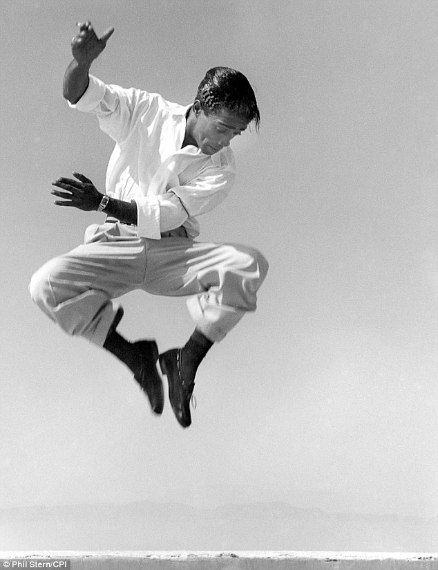 Cool cat on a roof: Another of the photographer's famed pictures was this image of a dancing Sammy Davis Jr in Hollywood