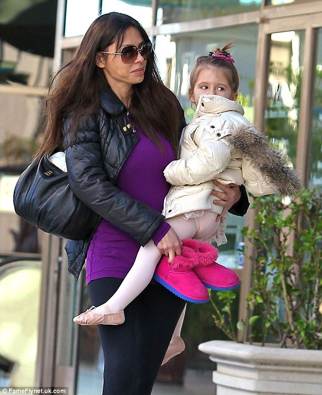 Lawsuits: Oksana and Mel have had many legal battles over the years, pictured with Lucia in Sherman Oaks in January last year