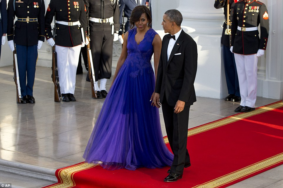 Michelle paid tribute to Japan by wearing a stunning purple gown by native designer Tadashi Shoji, who she has been known to wear before