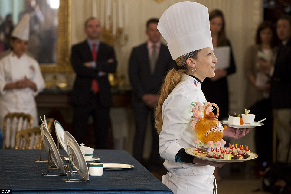 Dessert: White House pastry chef Susan Morrison holds up desserts for Tuesday's State Dinner hosted by President Barack Obama for Japanese Prime Minister Shinzo Abe