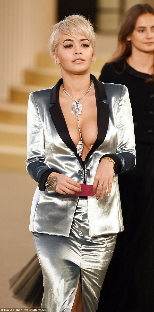 Rita Ora appeared at Chanel's Paris show this week in a navel-skimming metallic tux, which showed off a sizable amount of cleavage