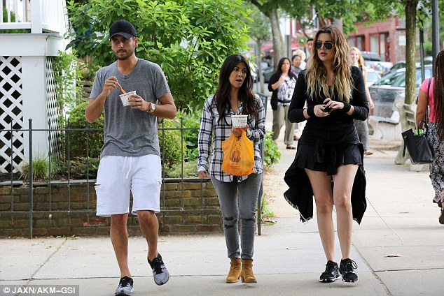Three amigos: The 35-year-old was was taking a break from filming with her partner Scott Disick and sister Khloe as they continue production on their spin-off show, Kourtney & Khloe Take The Hamptons