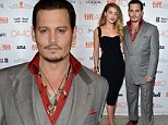 """Johnny Depp and Amber Heard attend a premiere for """"Black Mass"""" on day 5 of the Toronto International Film Festival at the Elgin Theatre on Monday, Sept. 14, 2015, in Toronto. (Photo by Evan Agostini/Invision/AP)"""