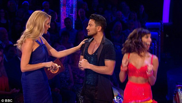 Peter Andre, pictured with presenter Tess Daly and his dance partner Janette Manrana, has been announced as the 10-3 favourite to lift the Glitterball trophy by Bookmaker Coral