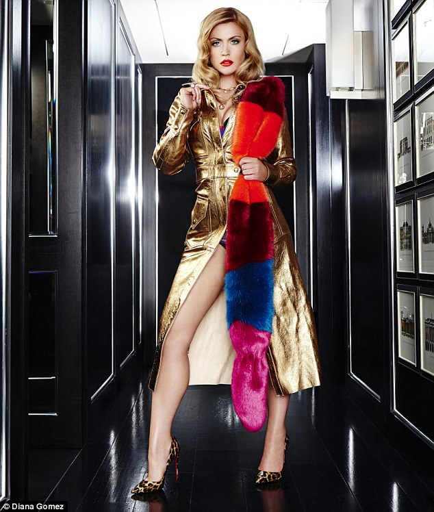 Camilla is wearing GOLD TRENCHCOAT, Bimba & Lola; FAUX-FUR STOLE, Helen Moore; BRA, Elle Macpherson Intimates; NECKLACE AND RING, Maria Francesca Pepe; SHOES, Christian Louboutin