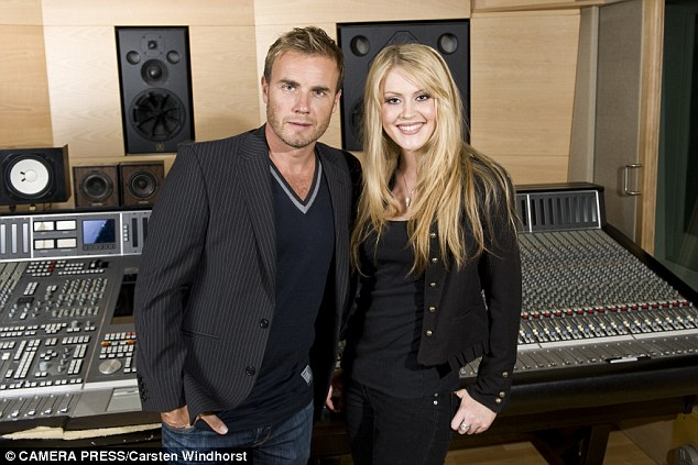 Camilla with Gary Barlow who signed her to his label, in 2009. She bombarded him with her home recordings of 'Ave Maria' and 'Pie Jesu' every day for six weeks until the Take That star finally listened to them