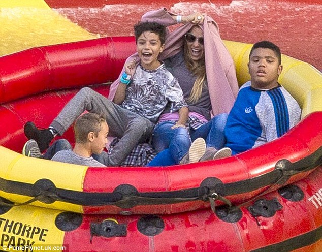 The fun never stops! The 37-year-old also hopped into a large inflatable seat with her boys Harvey and Junior for a wet and wild ride
