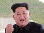 epa04929495 An undated picture released by the Rodong Sinmun, the newspaper of the North Korea ruling Workers Party, on 14 September 2014 shows North Korean leader Kim Jong-un smiling with a cigarette in one hand during his inspection of the construction site for a hydroelectric power plant on Mount Paektu, an area bordering with China. Kim asked for a speedy dedication of the plant, which he named the Paektusan Hero Youth Power Station.  EPA/Rodong Sinmun SOUTH KOREA OUT - BEST AVAILABLE QUALITY