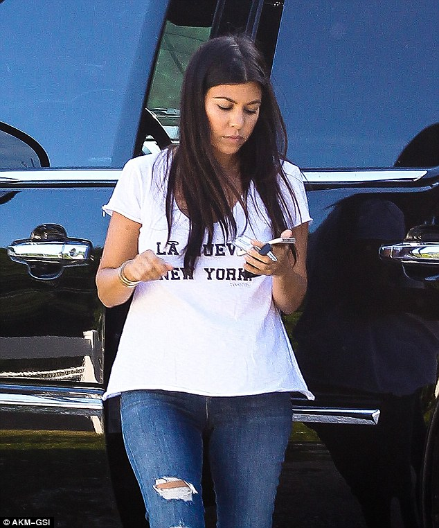 Covering her bump! The Calabasas-raised socialite showed her hometown pride in a $62 'LA Nueva New York' T-shirt from Newport Beach-based brand Twenty