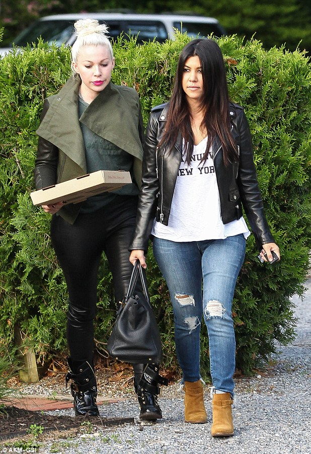 Nourishing her inner-child: Pregnant Kourtney Kardashian - who's due in December - was spotted grabbing a pizza with a blonde gal pal in Southampton Wednesday