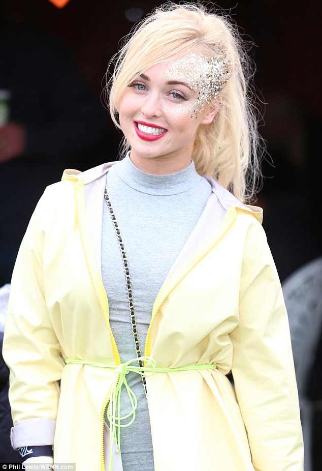 Glittery: The Hollyoaks babe wore a neon-yellow rain mac over a skintight grey mini-dress for the annual music event