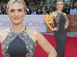 """Actress Kate Winslet poses for photographs as she arrives on the red carpet at the gala for the film """"The Dressmaker,"""" at the 2015 Toronto International Film Festival in Toronto on Monday, Sept. 14, 2015. (Frank Gunn/The Canadian Press via AP)"""